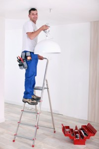 Handyman fixing lighting